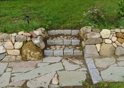 Trappe udført i granit kantsten og pigsten